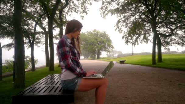 Woman working laptop. Remote working concept. Woman using laptop outside