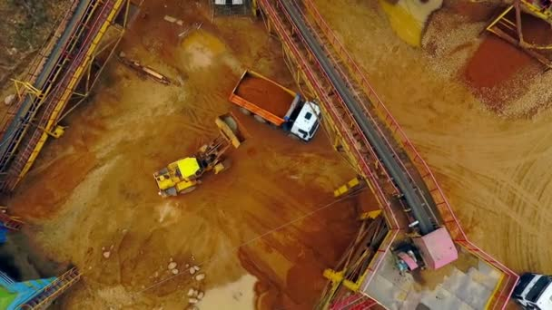 Excavator loader load sand in dumper truck. Aerial view. Sand work
