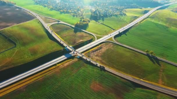 Drone view cars moving on highway junction. Landscape road junction on highway