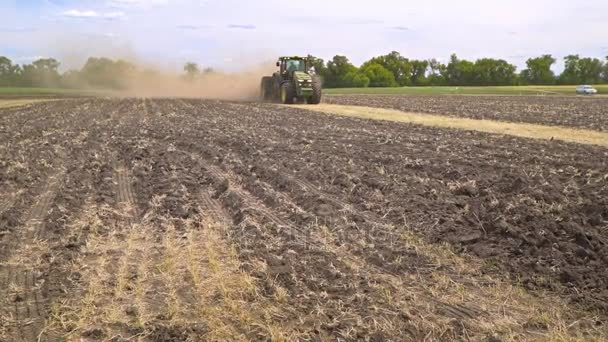 Farming tractor working on arable field. Agricultural tractor plowing land