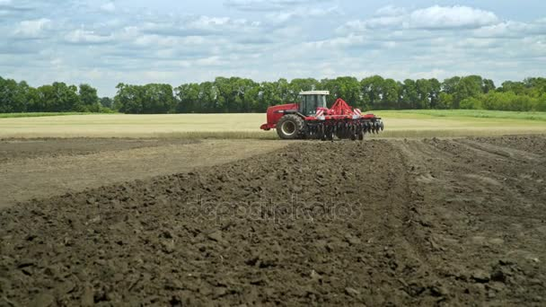 Rural farming. Plowed land. Agriculture machinery. Farming tractor