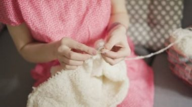 Knitting woman making wool clothes. Creative woman knitting hands