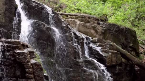 Stone waterfall in mountain forest. Waterfall on rocky mountain