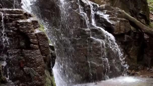 Beautifull waterfall in rocky mountain. Water flow downhill in wild forest