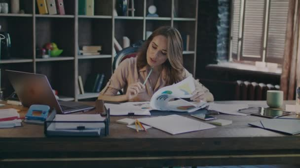 Attractive business woman reading documents. Analysing data. Business process