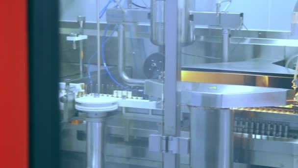 Pharmaceutical manufacturing machine at factory. Drugs manufacturing line