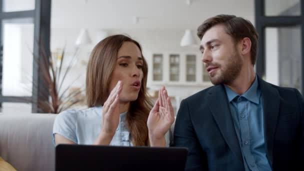 Business woman arguing with man at home office in slow motion.