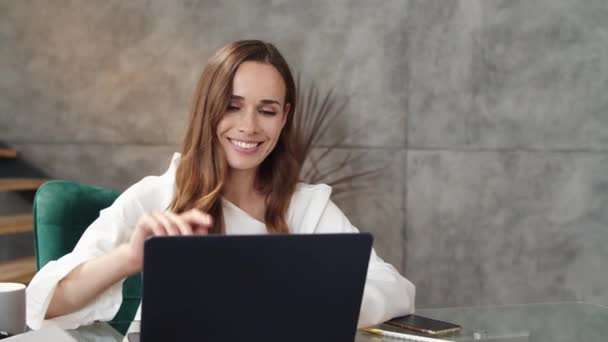 Smiling business lady making conference call on laptop. Girl working laptop.