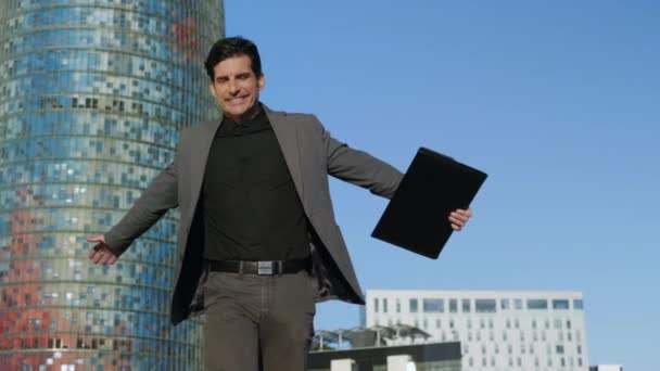 Businessman jumping after successful meeting. Manager walking on city street