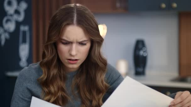 Focused business woman reading documents at home. Upset girl checking data
