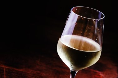 Dry cold white wine, vintage dark wood background