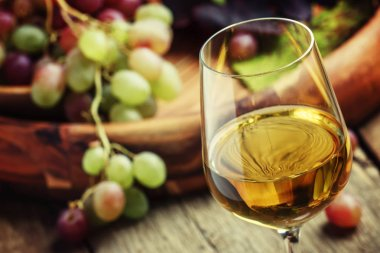 Autumn ice wine, ripe grapes and dried leaves