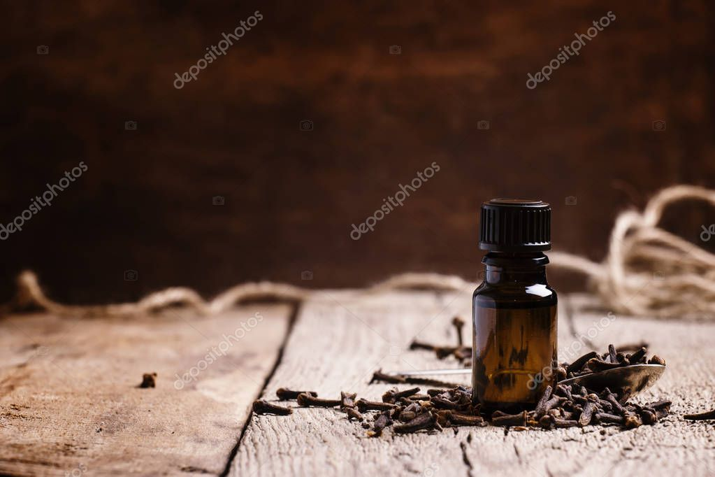 Essential oil of cloves in a brown bottle