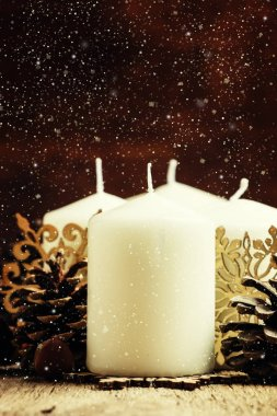 New Year composition with big white candles
