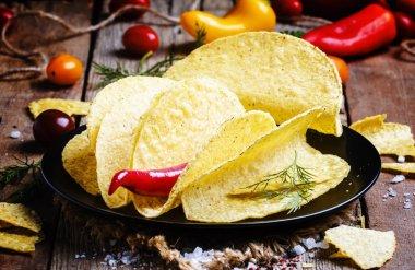 Tacos on plate. Vintage wood background