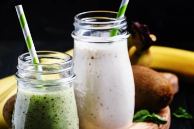 Kiwi and banana smoothies in bottles