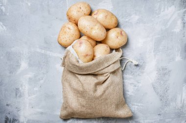Fresh potatoes in a canvas bag