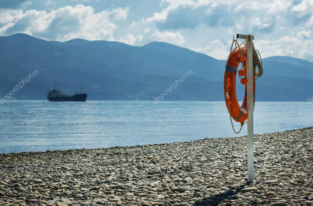 Lifebuoy on the beach, summer landscape, selective focus