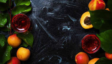 Homemade apricot  liqueur and fresh fruits, top view