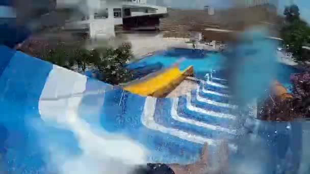 Man in the water park. Active rest, water park, water slides, action camera.