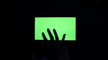 A tablet with a green screen. Tablet computer with a green screen.