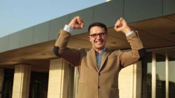 A man businessman rejoices in success.
