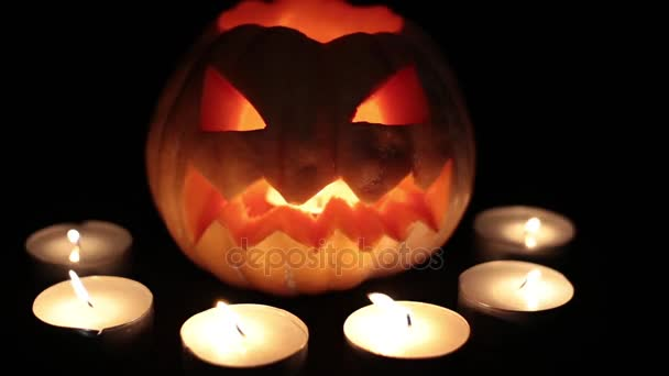 halloween and all saints day an evil pumpkin jack with burning candles stock