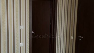 A woman enters the hotel room. Tourism and travel.