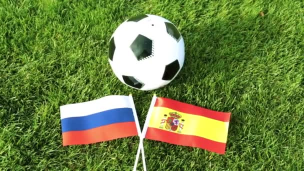 Soccer ball and flags of Russia and Spain. Football, World Cup.