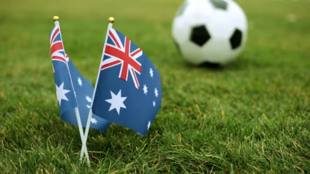 Flag of Australia and soccer ball. Australian flag and ball on the grass.