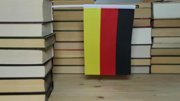 Flag of Germany and paper books. German flag with books.