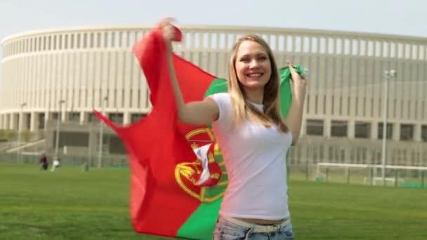 A nő sport rajongó egy portugál zászló. Nő, Portugália zászlaja