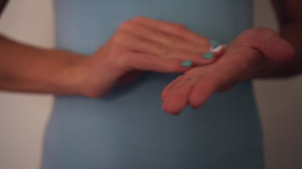 A woman rubs her hands with a disinfectant alcohol wipe. Coronovirus Prevention