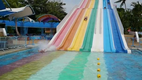 people have fun sliding down in Aquapark