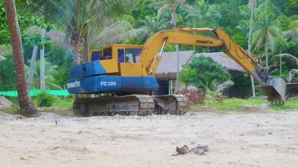 PHANGAN, THAILAND - March 28,2017:excavator working in the tropics