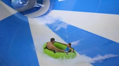 NOVOSIBIRSK,RUSSIA - November 02,2017: The family relaxes and has fun in the water Park on the rides