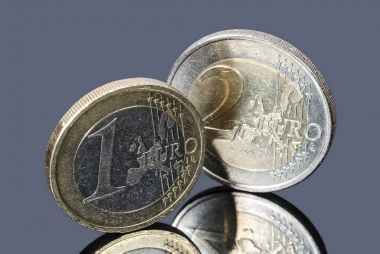 Coins of one and two Euro on a gray background