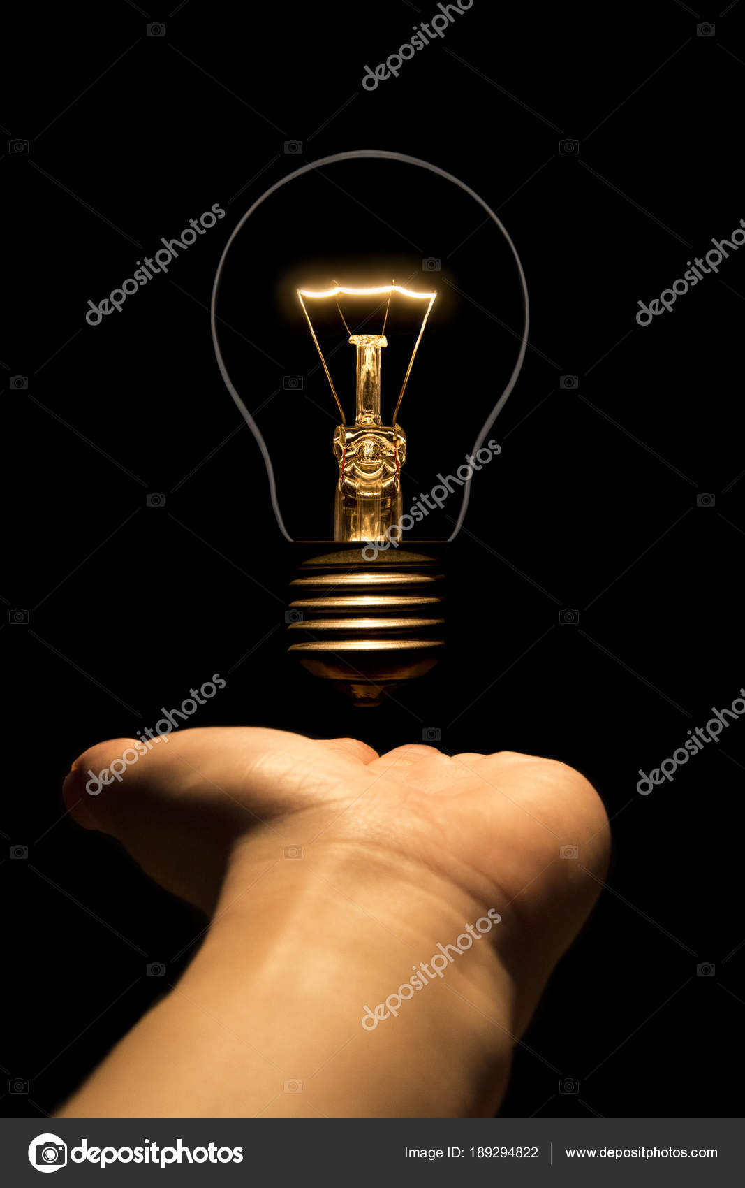 Hand Holding A Filament Lamp On A Black Background Stock Photo