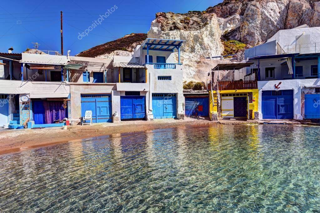 MILOS ISLAND - GREECE / 09.11.2017: Traditional fishermen houses and boat shelters at Firopotamos Beach, Milos Island, Greece