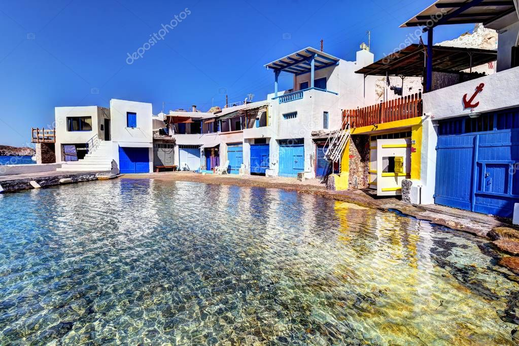 MILOS ISLAND - GREECE / 09.11.2017: Traditional fishermen houses with the boat shelters at Firopotamos Beach, Milos Island, Greece