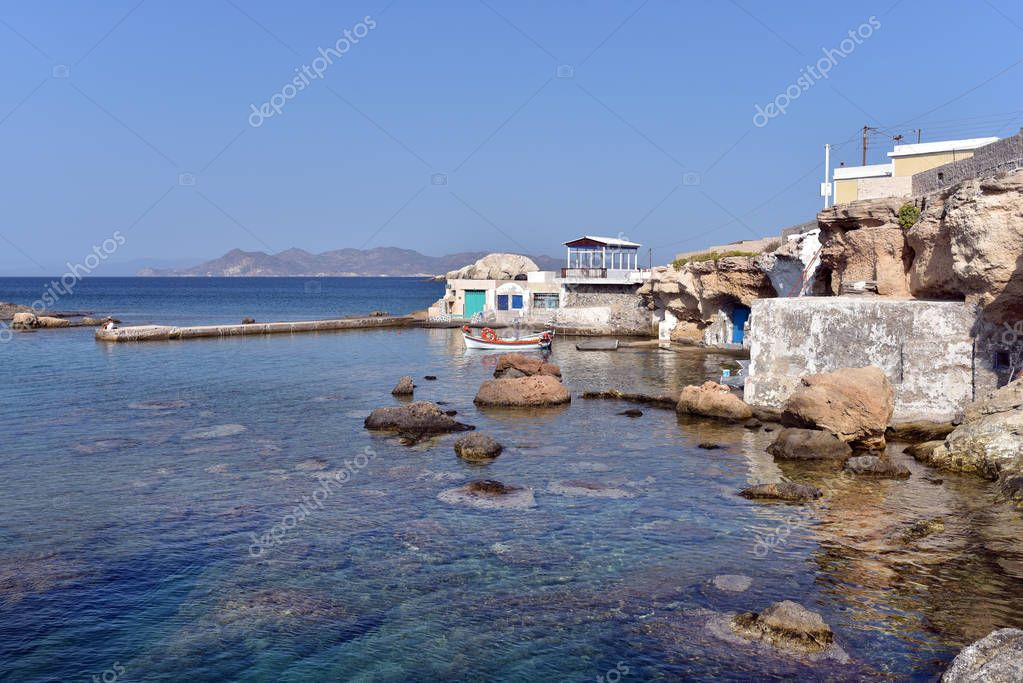 MILOS ISLAND - GREECE / 09.12.2017: Small harbour with fishing boats in Mandrakia village on the northern coast of Milos island