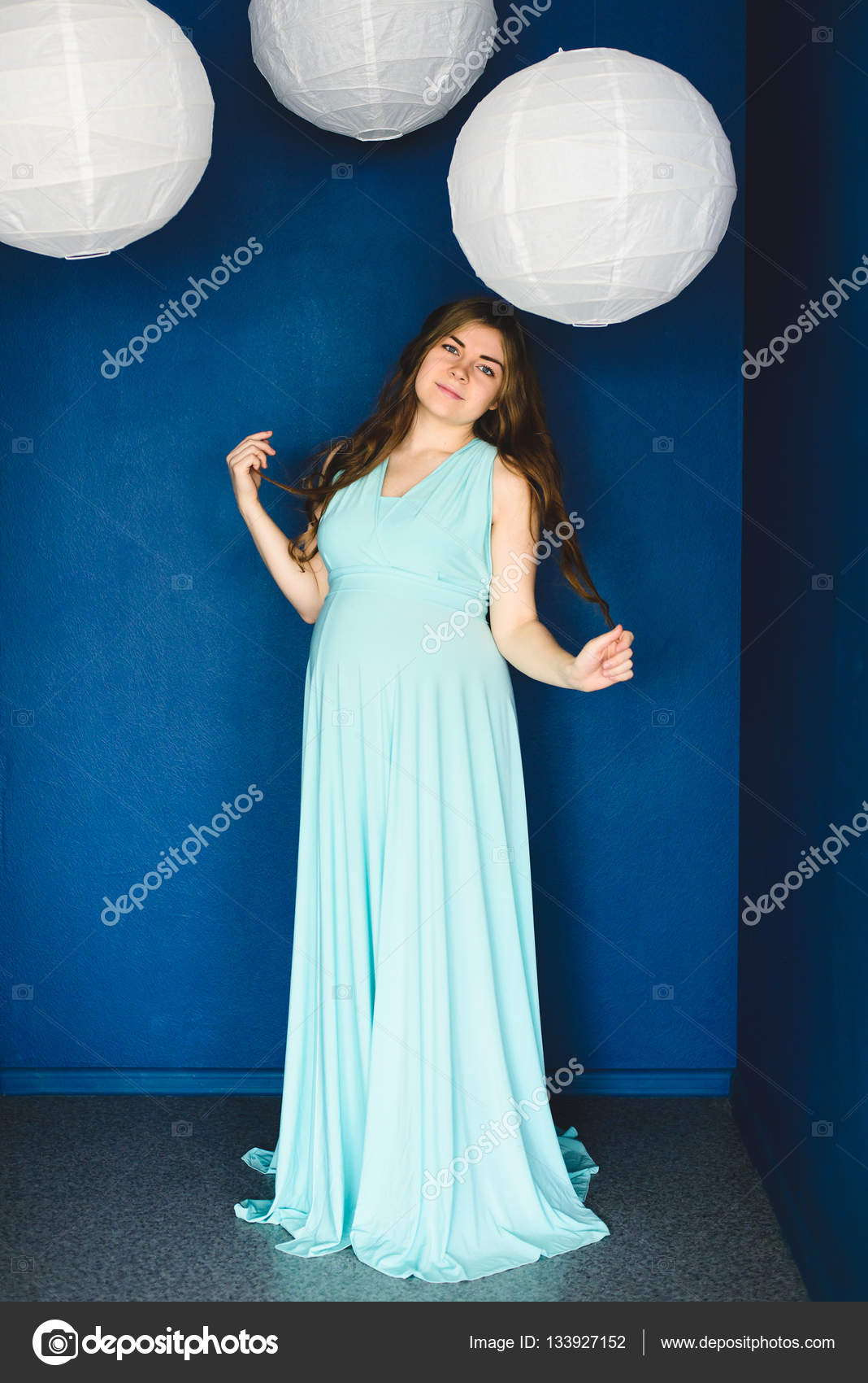 pregnant woman posing in the studio — Stock Photo © apagafonova ...