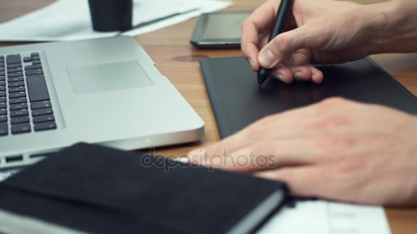 Male hands of using drawing tablet. Designer working with graphics tablet