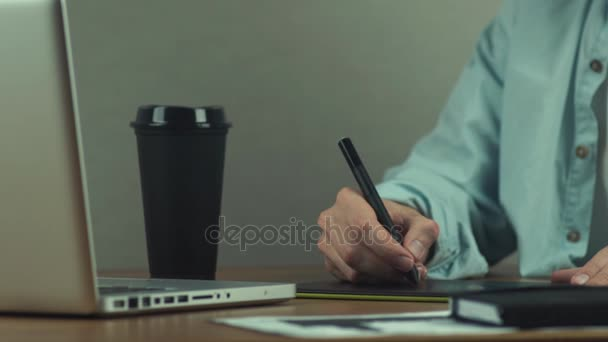Man working with graphics tablet, hands of man working with drawing tablet