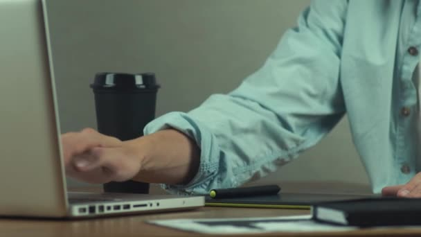 Designer working with graphics tablet, hands of man using laptop