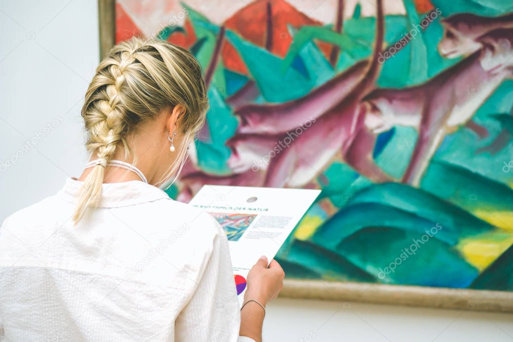 HAMBURG, GERMANY - 9 JULY 2017: Hamburg museum of art. Jung woman on painting exhibition