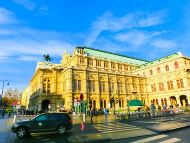 Vienna, Austria - January 02, 2015: Moving Traffic in front of The State Opera House