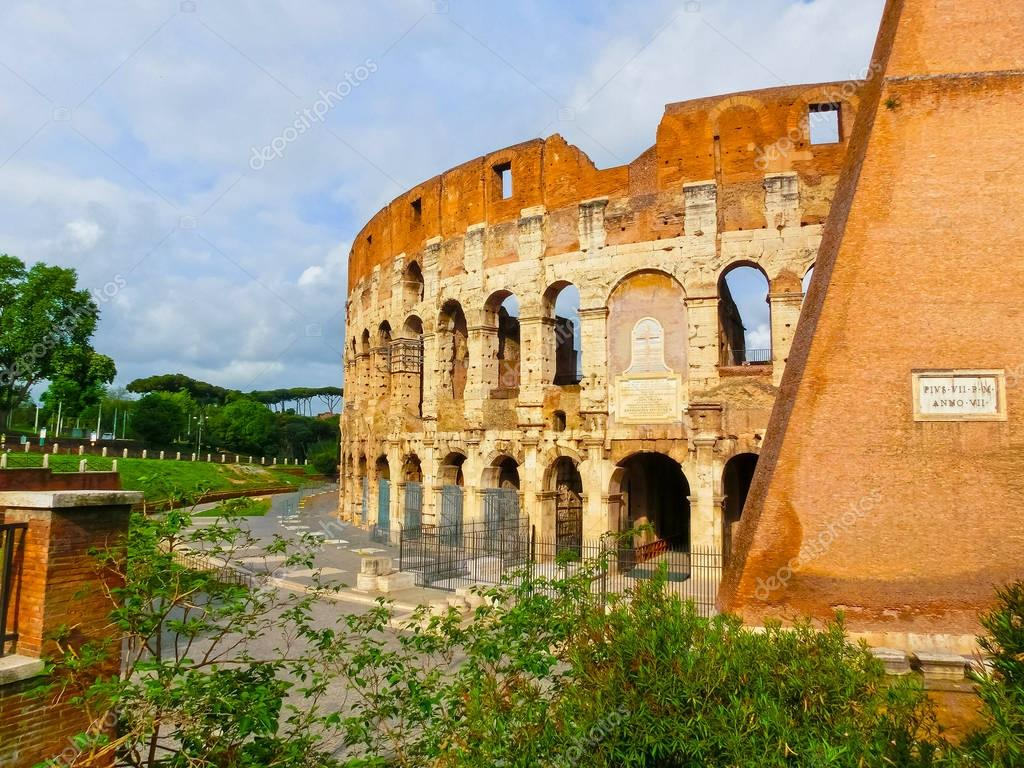 View of Colosseum in Rome and morning sun, Italy