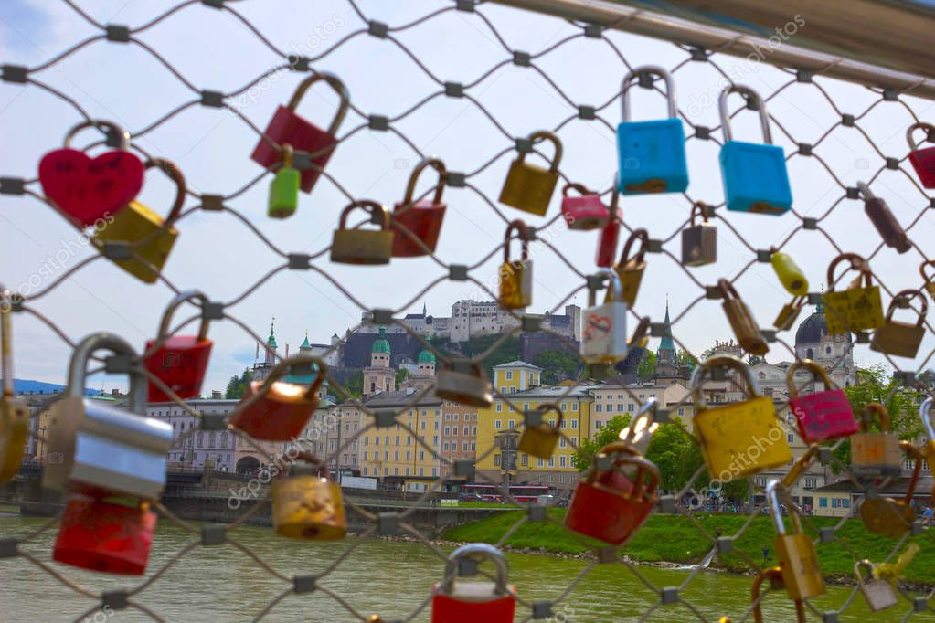 The bridge fence covered with locks in Salzburg. Salzburger Land, Austria