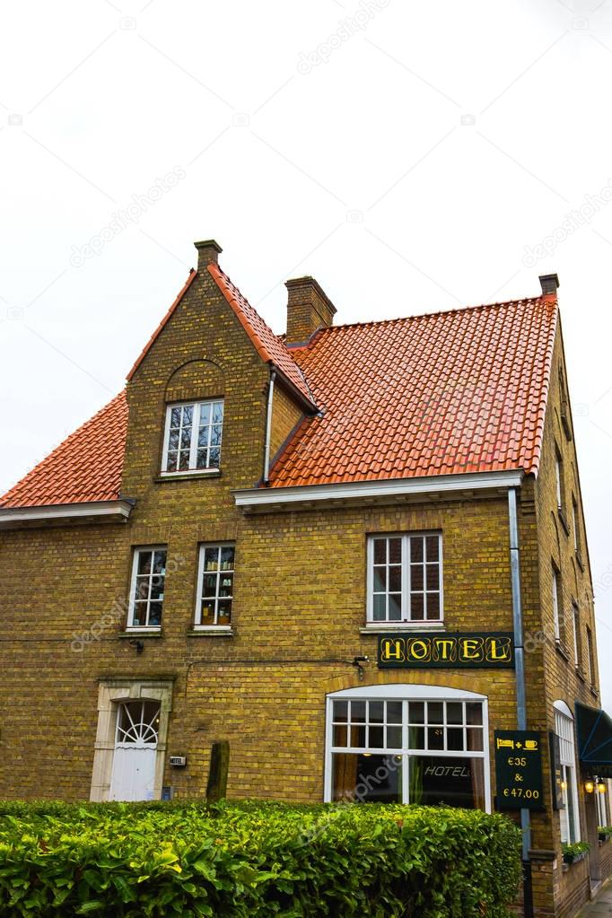 Bruges, Belgium - December 13, 2017: Old hotel restaurant in the historic center of Bruges. The house in the traditional Belgian style.